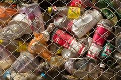Municipal bin full of drinks Royalty Free Stock Image