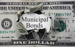 Municipal bond dollar. Municipal Bond message in a torn dollar bill Royalty Free Stock Images