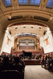 Municipal House Prague. The main concert hall in the Municipal House in Prague, the philharmonic orchestra performing a Piano Symphony Royalty Free Stock Photos