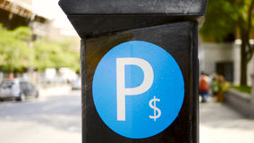 Municipal parking machine in Montreal, Canada royalty free stock photography