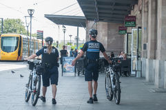 Municipal police patrolling by mountain bike in front of the train station. MULHOUSE - France - 14 June 2017 - Municipal police patrolling by mountain bike in Royalty Free Stock Photography