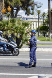 Municipal Policeman directs traffic in Nice Stock Photography