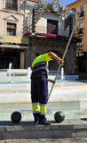 Municipal sweeper cleaning a city fountain Royalty Free Stock Image