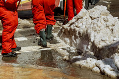Municipal urban servicing workers shoveling snow during winter road cleaning Royalty Free Stock Photos