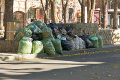 Municipal waste. The bags of household waste on a city street royalty free stock photo