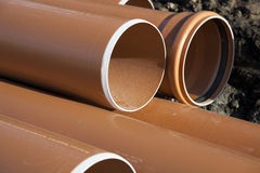 Municipal water pipes or mains. Closeup of large municipal water pipes or water mains waiting to be installed at a utility construction site Royalty Free Stock Image
