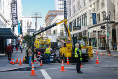 Municipal Workers Make City Infrastructure Service Activity At Downtown Street Royalty Free Stock Image