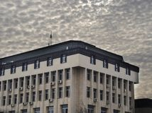 Municipality building under dense clouds. Municipality building in and the dense clouds behind it. Picture taken in Asenovgrad, Bulgaria on 8th of January 2018 Royalty Free Stock Photo