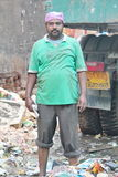 Municipality worker at work location. This picture was taken in Bangalore, India. We can see the municipality worker at the work location, clearing all the Royalty Free Stock Images