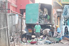 Municipality workers Clearing the wastage. This picture was taken in Bangalore, India. We can see the municipality people cleaning the area Royalty Free Stock Image