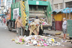 Municipality workers Clearing the wastage. This picture was taken in Bangalore, India. We can see the municipality people cleaning the area Stock Photo