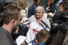 Munira Subasic at the Mladic trial. The Hague, Holland - June 3, 2011: Munira Subasic of 'Mothers of Srebrenica' is interviewed by the press at the Jugoslavia royalty free stock photo