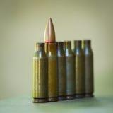 Munizioni con e senza le pallottole Fotografia Stock Libera da Diritti