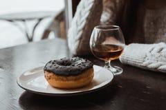 Munk cognac medf8ort mood royaltyfria bilder