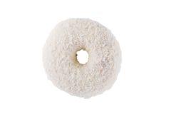 Munk i vita glasyr på kaka- och kokosnötflingor Arkivfoto