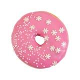 Munk med rosa glasyr på kaka och dekorativa stänk arkivfoton