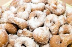 Munkar som dammas av med socker Royaltyfri Fotografi