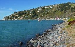 Munks fjärd & Redcliffs med den Christchurch yachtklubban i backgroun Royaltyfri Foto