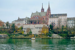Munster of Basel. Panorama of the city of Basel, Switzerland, with Munster (Cathedral) taken in November gloomy day from Rhine quay Stock Image
