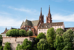 Munster of Basel, Switzerland. View up to the famous Basel cathedral with observation point and Basel flag Stock Photos