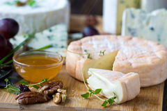 Munster and blue cheese. On wooden background Royalty Free Stock Images