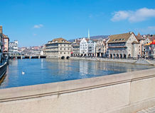 On the Munster bridge. The walk along the Munster bridge with a view on Limmat river, stepped gable houses of Zurich, Rathaus City Hall and the Rathaus bridge Stock Images