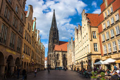 Munster, Germany. MAY 9: People on street on May 9, 2013 in . Largely destroyed during World War II, it was reconstructed from 1947 to 1958 Royalty Free Stock Photography