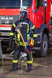 German fireman puppet stands near a fire engine on a presentation royalty free stock images