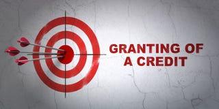 Muntconcept: doel en het Verlenen van a-krediet op muurachtergrond Stock Afbeeldingen