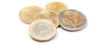Muntstukken 10 centen aan twee die Euro, op wit worden geïsoleerd Stock Afbeelding