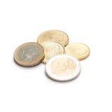 Muntstukken 10 centen aan twee die Euro, op wit worden geïsoleerd Stock Afbeeldingen