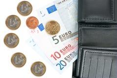 Muntstukken en bankbiljetten stock foto's