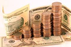 Muntstukken en contant geld stock fotografie