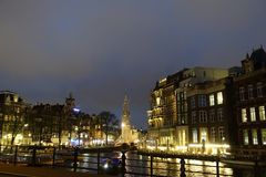 Munttoren as seen from the river Amstel at night. Munttoren as seen from the river Amstel by night Stock Photography