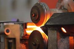 Muovere la barretta di metallo heated Immagine Stock
