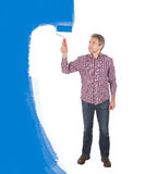 Mur adulte aîné de peinture dans le bleu Photographie stock libre de droits