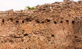 Mur antique de pierre et de mortier à Pompeii photographie stock libre de droits