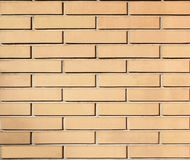 Mur avec des briques d'ocre de tellow d'embossep Photos stock