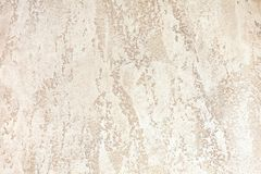 Mur avec le plâtre décoratif de couleur brun clair milieux texturisés photos stock