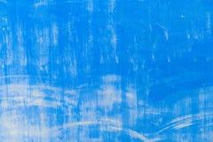 Mur bleu texturisé avec des souillures Image stock
