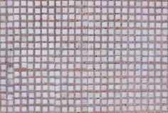 Mur carrelé avec de petits panneaux portés  Image stock