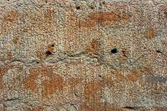 Mur déformé par grunge avec des trous photographie stock libre de droits
