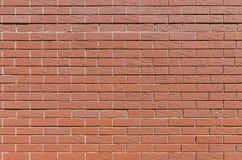 Mur d'une brique rouge égale, fond, série de texture Images stock