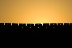 Mur dans le coucher du soleil Photographie stock libre de droits