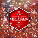 Mur de briques avec le label rouge de typographie de Noël Photographie stock libre de droits