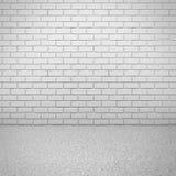 Mur de briques blanc avec le plancher en béton Intérieur vide de pièce Image libre de droits
