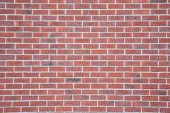 Mur de briques coloré rouge antique Images libres de droits