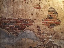 Mur de briques criqué Photographie stock libre de droits