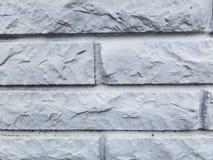 Mur de briques en pierre blanc sur l'extérieur d'un bâtiment Photo libre de droits