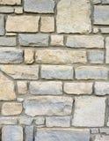 Mur de briques en pierre extérieur avec le mortier Photographie stock libre de droits